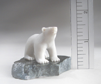 MINI POLAR BEAR ON BLACK ROCK